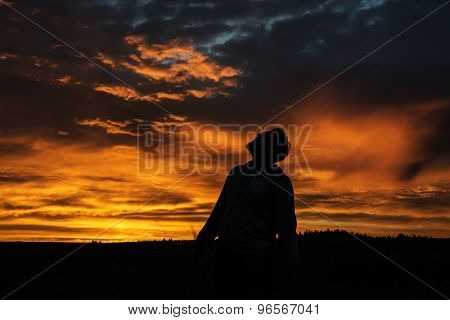Man Silhouette on Sunset Background