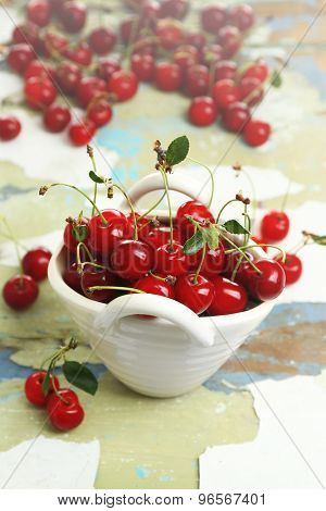 Fresh cherries on cracked wooden table, closeup