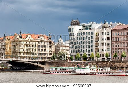 View on Vltava river,bridge and famous Dancing House building in Prague
