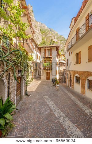Narrow street of old apartment buildings in Malcesine, Italy.