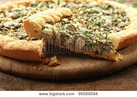 Slices of open pie with spinach on table close up