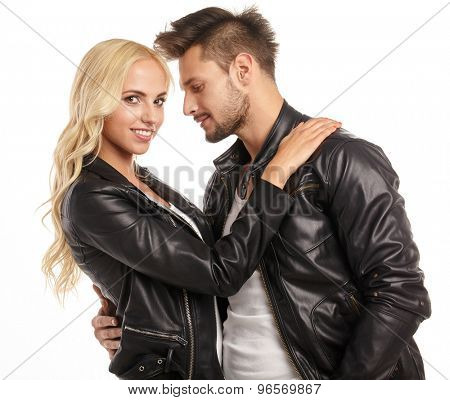 happy fashion couple in leather jackets  in studio