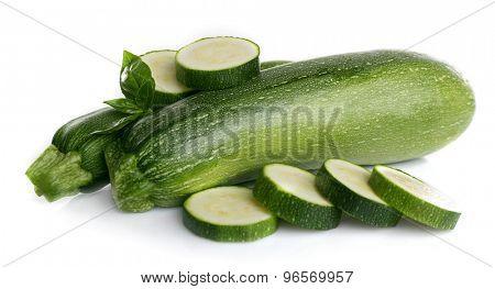 Fresh zucchini with basil isolated on white