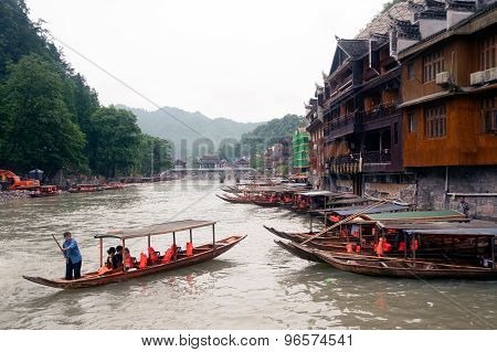 Tourists Boat On The River In Fenghuang Ancient City.