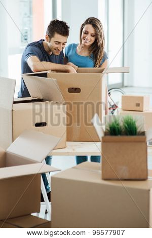 Smiling Couple Moving In A New House