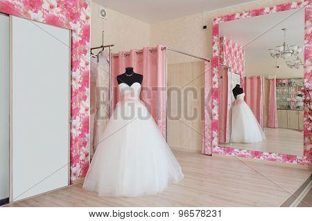 Wedding dresses in a show-room of a wedding salon