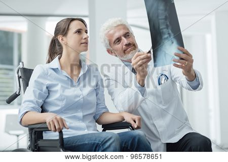 Doctor Examining A Patient's X-ray