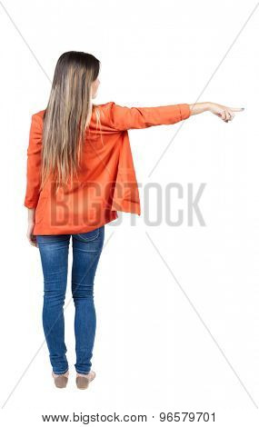 Back view of  pointing woman. beautiful girl. Rear view people collection.  backside view of person.  Isolated over white background. The girl in the red jacket is pointing the index finger to right.