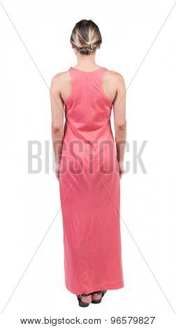 back view of standing young beautiful  woman.  girl  watching. Rear view people collection.   Isolated over white background. girl in a light red dress standing and looking in front of him.
