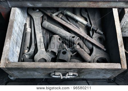 Different tools in box on workplace in garage