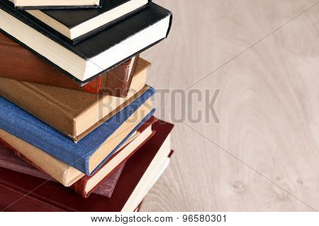 Heap of old books on wooden background