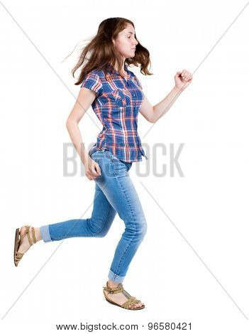 back view of running  woman in jeans. beautiful blonde girl in motion. backside view of person.  A young girl in a checkered blue with red stripes running with developing hair.
