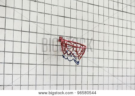 Basketball hoop against a wall
