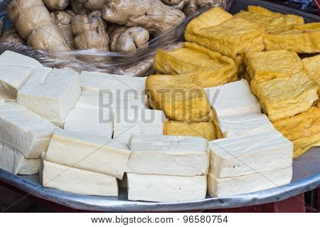 Different Types Of Tofu On A Metal Tray