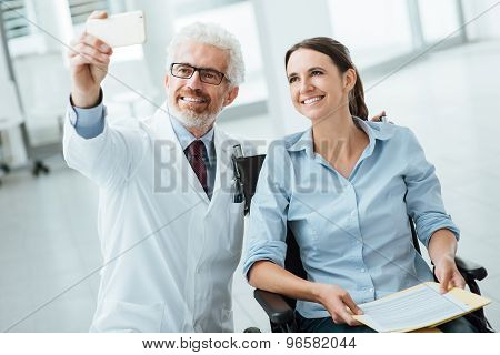 Doctor Taking A Selfie With A Woman In Wheelchair