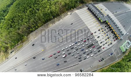 RUSSIA, MOSCOW - JUL 5, 2014: Top view of traffic on road at summer day. Aerial view. Photo with noise from action camera. Photo with noise from action camera