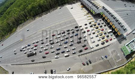 RUSSIA, MOSCOW - JUL 5, 2014: Top view of transport traffic on chargeable road. Aerial view. Photo with noise from action camera. Photo with noise from action camera