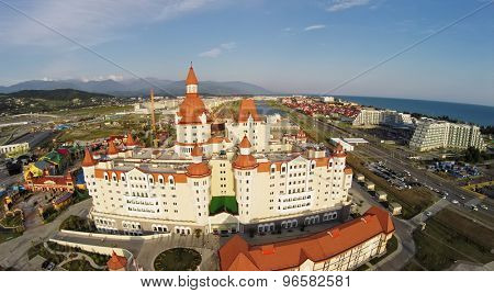 RUSSIA, SOCHI - JUL 27, 2014: Sochi-park near hotel Bogatyr at summer sunny day. Aerial view. Photo with noise from action camera.