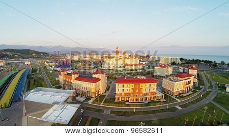 RUSSIA, SOCHI - JUL 27, 2014: Five color pedestrians bridges near Sochi-park and hotel Bogatyr at summer day. Aerial view. Photo with noise from action camera.