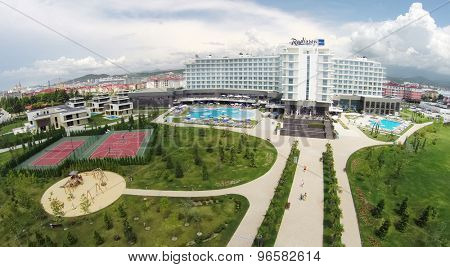 RUSSIA, SOCHI - JUL 25, 2014: Complex of hotel Radisson Blu at summer day. Aerial view. Photo with noise from action camera.