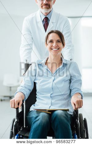 Doctor Pushing A Patient In Wheelchair