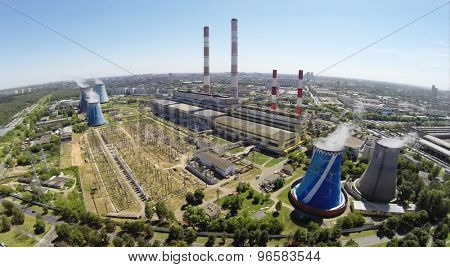 RUSSIA, MOSCOW - JUL 14, 2014: Cityscape with power plant at sunny summer day. Aerial view. Photo with noise from action camera.