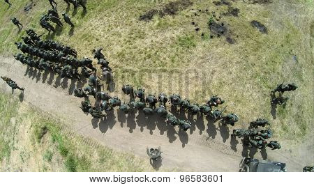 RUSSIA, NELIDOVO - JUL 12, 2014: Soldiers in uniform of german and soviet armies on field during reconstruction Battlefield at summer sunny day. Aerial view. Photo with noise from action camera