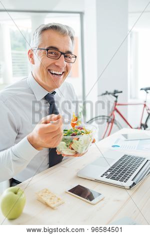 Happy Businessman Having An Healthy Lunch