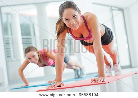 Girls Doing Push Ups At The Gym