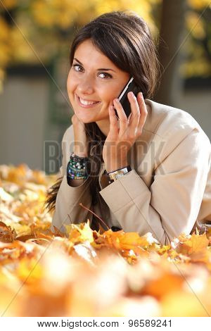 Young brunette woman calling by phone