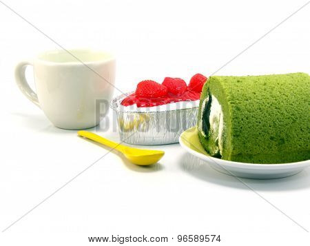 Strwberry Cheesecake And Green Tea Roll Cake On White Background