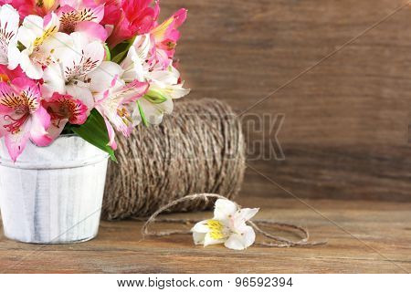 Bouquet of alstroemeria on wooden background