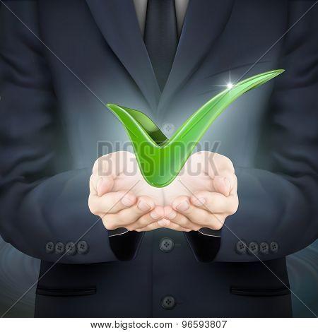 Businessman Holding Green Check Mark
