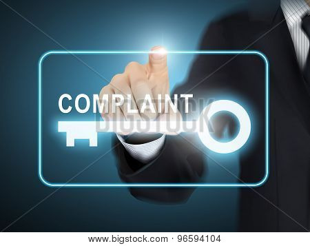 Male Hand Pressing Complaint Key Button