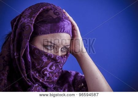Princess, Beautiful arabic woman with traditional veil on her face, intense look
