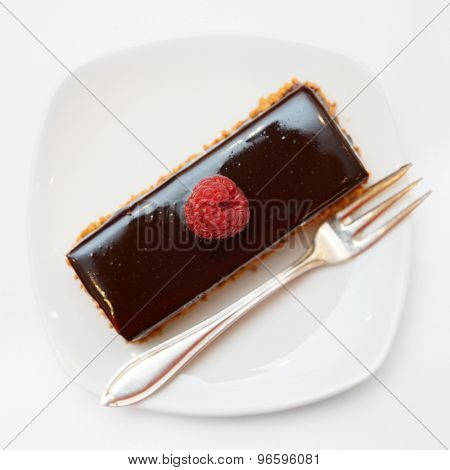 Piece of chocolate cake in small plate shot from above