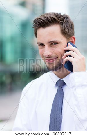 Businessman chat on mobile phone at outdoor