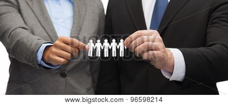 business and office concept - businessman and businesswoman holding paper team