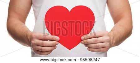 relationships and love concept - closeup of man hands with heart