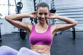 picture of crunch  - Portrait of a muscular woman doing abdominal crunch - JPG