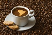 image of continent  - Still life photography of hot coffee beverage with map of South America continent - JPG