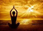 Yoga Meditation Concept, Woman Silhouette Meditating In Healthy Pose, Sun Light Rays poster