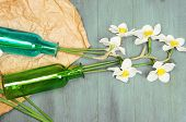 stock photo of daffodils  - Beautiful daffodils in vases on wooden background - JPG