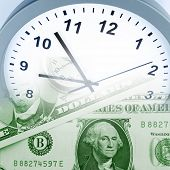 stock photo of american money  - Clock on assorted American banknotes - JPG