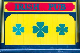 pic of irish  - Bright colorful Irish Pub sign in yellow and blue on a wooden background - JPG