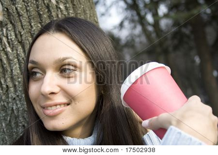 Closeup of woman drinking coffee