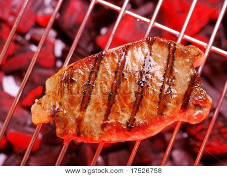 Hot  beefsteak on barbecue