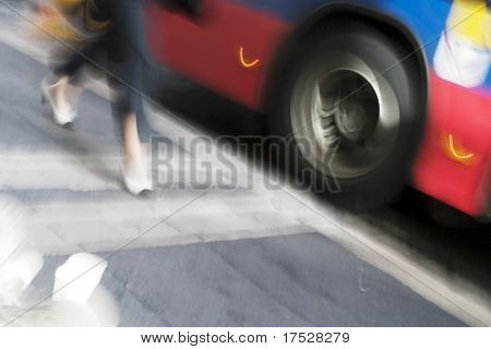 An abstract blurred image displaying someone running for the bus
