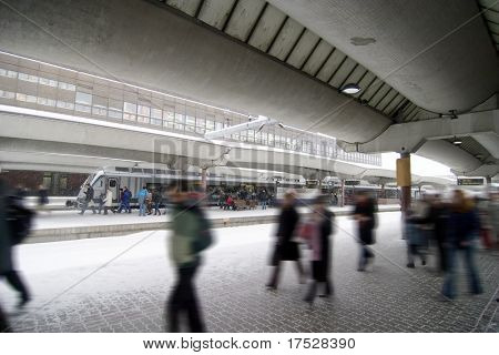 People at the Oslo main train station on a wintery day.