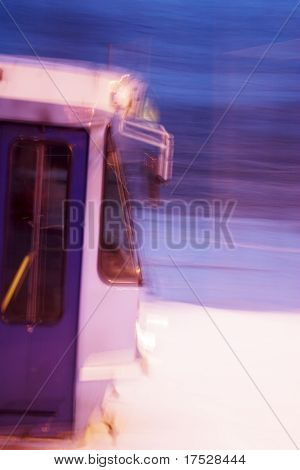 An Oslo street car at night with motion blur.